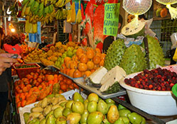 fruit stand in Colombia with spiky guanabana